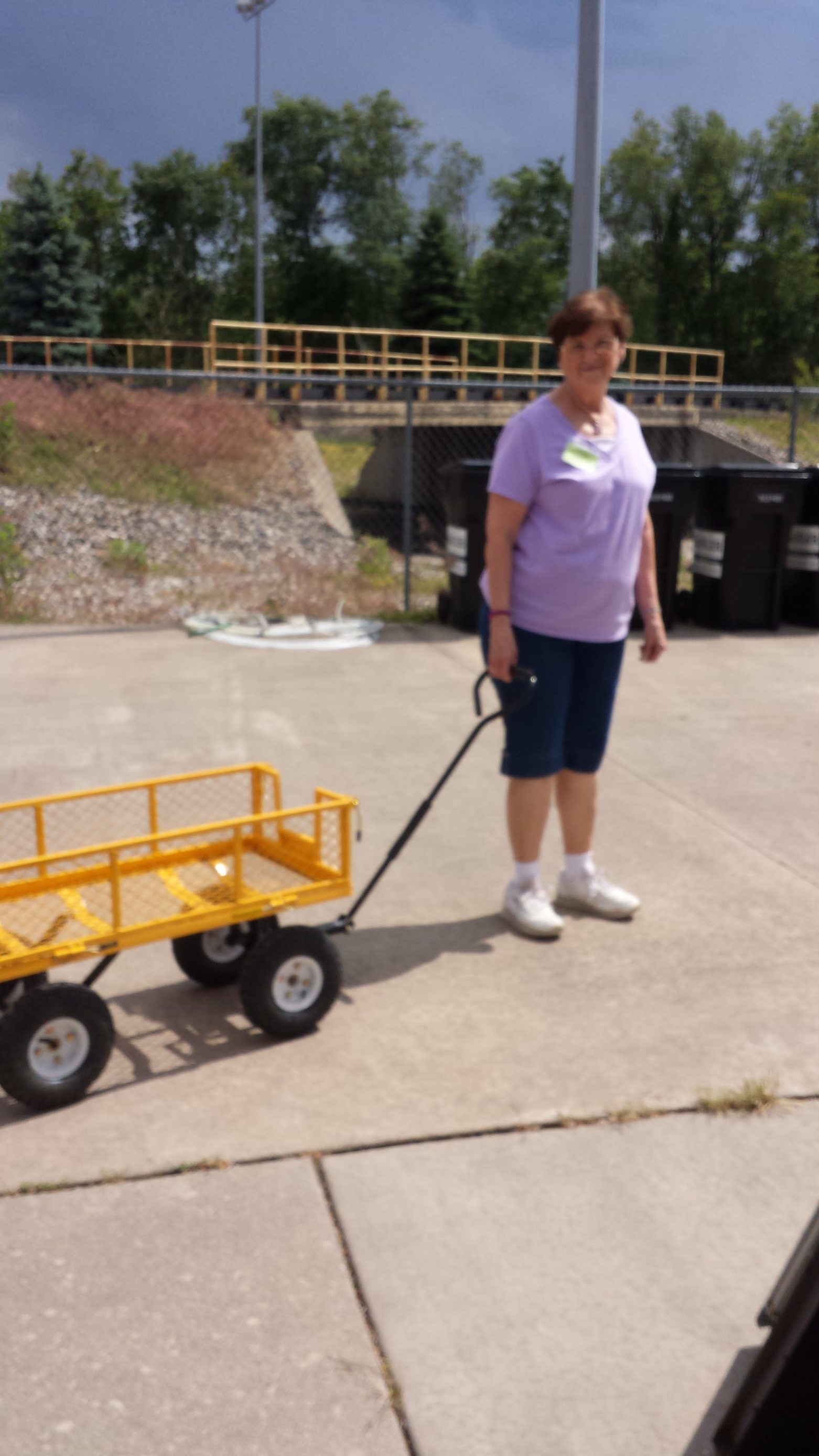 Volunteers use our Yellow Garden Carts to assist you in getting your selections to your car.