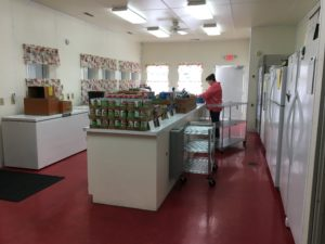 The front part of the pantry. Refrigerators, Freezers, and food sorting & selections.